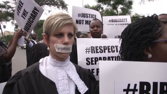 Zimbabwean lawyers march in the capital Harare and hand in a petition to the constitutional court for the restoration of rule of law and respect for...