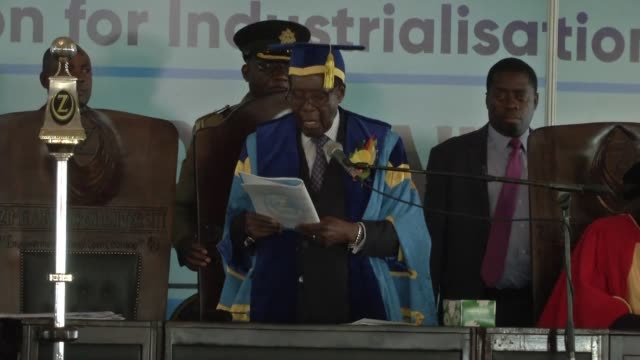zimbabwean president robert mugabe attendsa university graduation ceremony making his first public appearance since the military takeover that... - zimbabwe stock videos & royalty-free footage