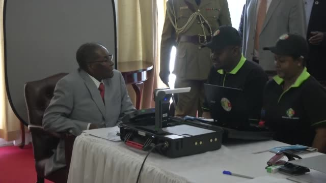 Zimbabwean President Robert Mugabe unveils a new biometric voter registration programme ahead of next year's elections which he will contest drawing...