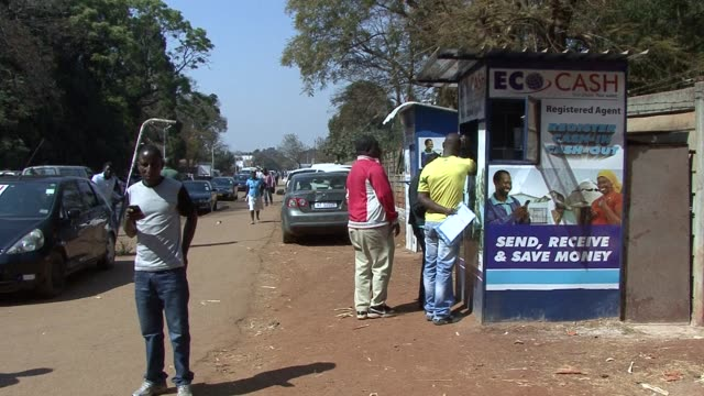 zimbabwean shoppers often feel literally short changed after the us dollar replaced the local currency a lack of coins has meant shoppers often... - sostituzione video stock e b–roll
