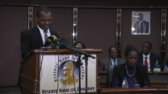 zimbabwe's central bank introduces an interbank foreign exchange system effectively devaluing its quasi currency which was officially pegged at par... - devaluation stock videos & royalty-free footage