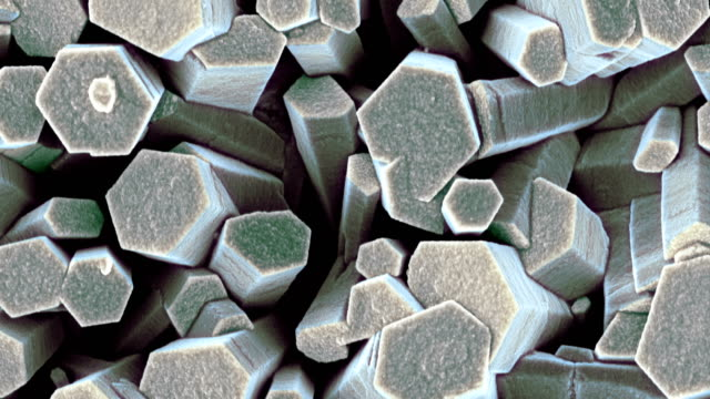zinc oxide crystals, sem - micrografia elettronica a scansione video stock e b–roll
