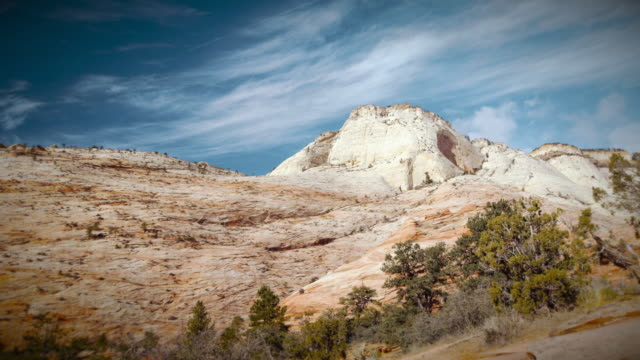 zion national park time lapse with sun and clouds - granite rock stock videos and b-roll footage