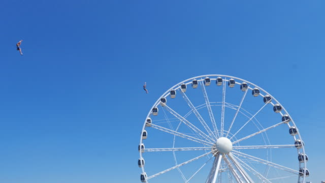 zip lining and ferris wheel. - big wheel stock videos & royalty-free footage