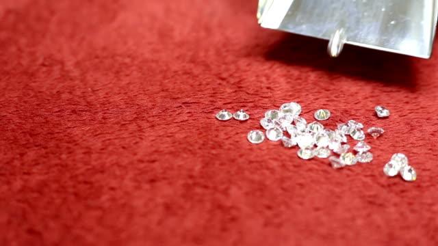 Zircon, Diamonds on red surface sorting