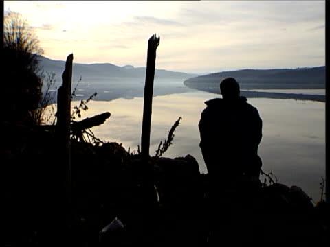 zivadin djordjevic looking out across river - slobodan milosevic stock-videos und b-roll-filmmaterial