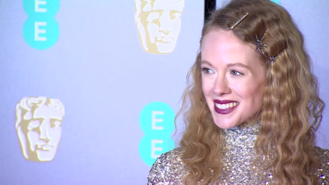 zoe boyle poses for photos on red carpet at bafta film awards at royal albert hall - red carpet event stock videos & royalty-free footage