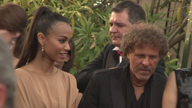 Zoe Saldana and Renzo Rosso at the Cannes Film Festival 2009 amfAR Red Carpet at Antibes