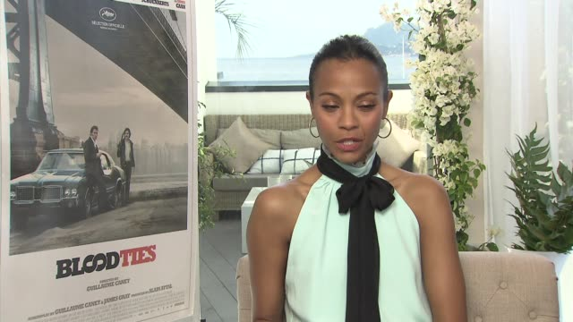INTERVIEW Zoe Saldana on how it was like working with Guillaume Canet comparing him to JJ Abrams at 'Blood Ties' Interview at Palais des Festivals on...
