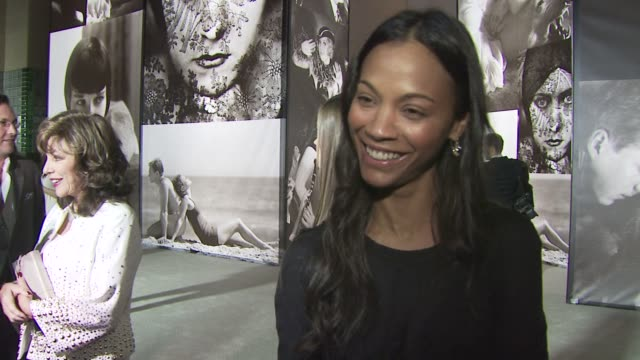 Zoe Saldana on the event on her favorite cover her own on Burberry She is carrying a Burberry purse at the Vanity Fair Burberry Host 'Vanity Fair...