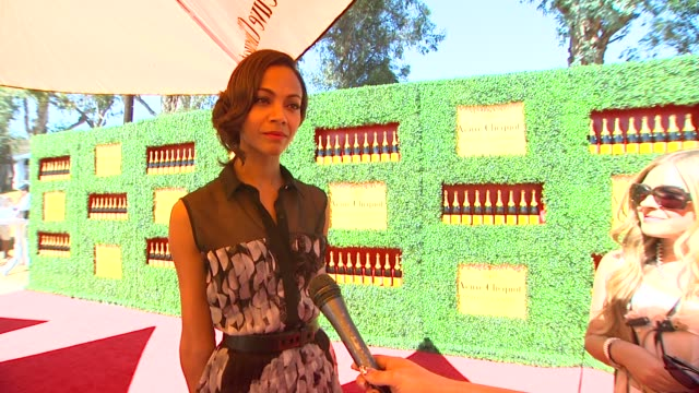 Zoe Saldana on what brings her to the Veuve Clicquot Polo Classic this being her first polo match tells about her polo style if she is excited to...