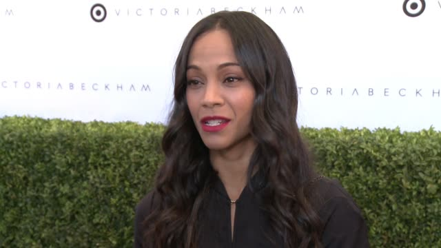 INTERVIEW Zoe Saldana on what we're celebrating what she's most looking forward to seeing from the collection talks about the look she's wearing what...