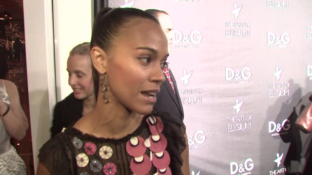 Zoe Saldana on why she loves Dolce Gabbana on what she's wearing on the Art of Elysium at the DG Flagship Boutique Opening Benefiting the Art of...