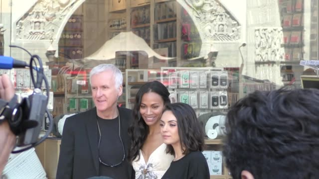 zoe saldana poses with james cameron & mila kunis at her star ceremony on the hollywood walk of fame in hollywood in celebrity sightings in los... - james cameron stock videos & royalty-free footage