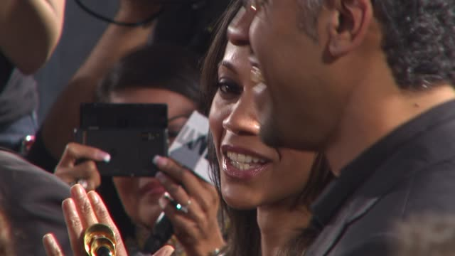 zoe saldana, sylvain white at the 'the losers' premiere at hollywood ca. - lipgloss stock-videos und b-roll-filmmaterial