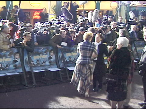 DAY * HANDHELD WS Zoe Wanamaker on walkway talking to press behind barricade at Leicester Square