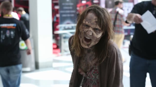 A zombie character from Overkill's The Walking Dead walks during the E3 Electronic Entertainment Expo in Los Angeles California US on Wednesday June...