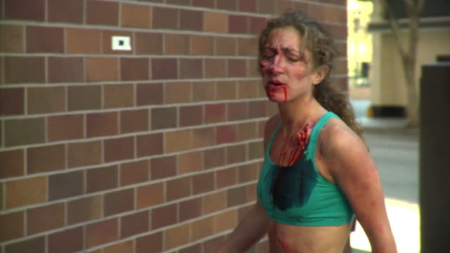 zombie girl steps off wall - zombie stock videos & royalty-free footage