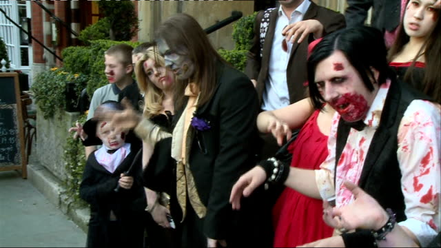 zombie themed wedding marks release of new computer game zombie guests and groom arriving / guests posing outside venue for family photo /... - rob zombie stock videos & royalty-free footage