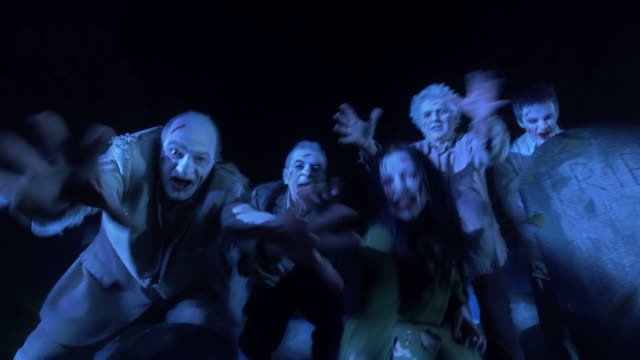 hd dolly: zombies reaching for human flesh - zombie stock videos & royalty-free footage