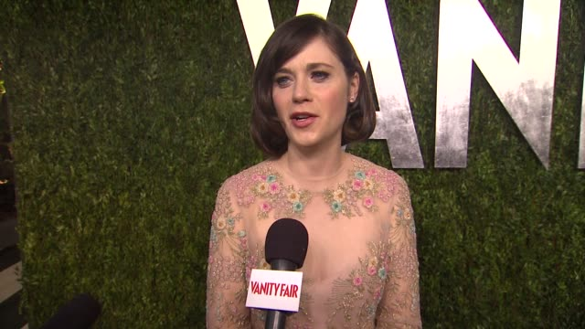 zooey deschanel on getting ready tonight, on her valentino dress, jokes that she's been coming to the party for 12 years and once stepping on janet... - oscar party stock videos & royalty-free footage