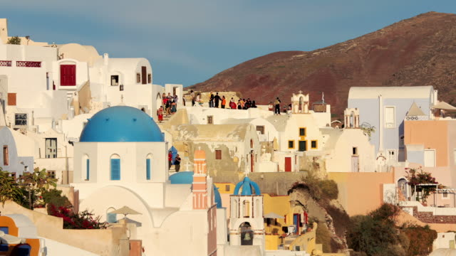 zoom back blue domes evening - oia santorini stock videos & royalty-free footage