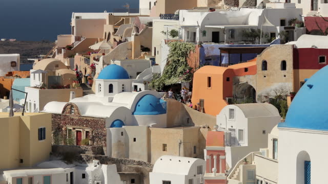 zoom back blue domes oia day 1 - oia santorini stock videos & royalty-free footage