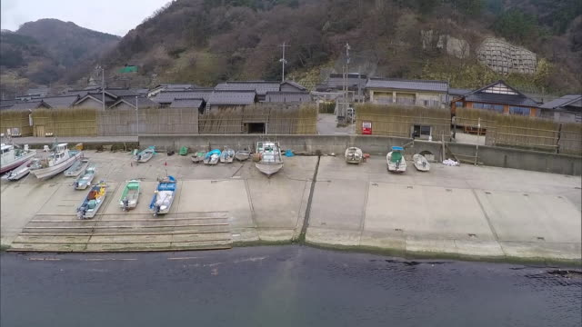 zoom back from magaki-no-sato; long shot covering ohzawa fishing port - multicopter stock videos & royalty-free footage