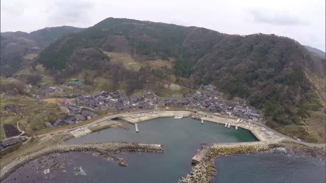 zoom back from magaki-no-sato; wide shot covering ohzawa fishing port - multicopter stock videos & royalty-free footage