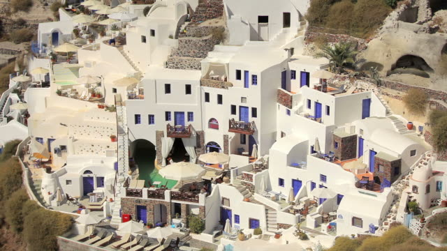 zoom back oia with windmills day 1 - oia santorini stock videos & royalty-free footage