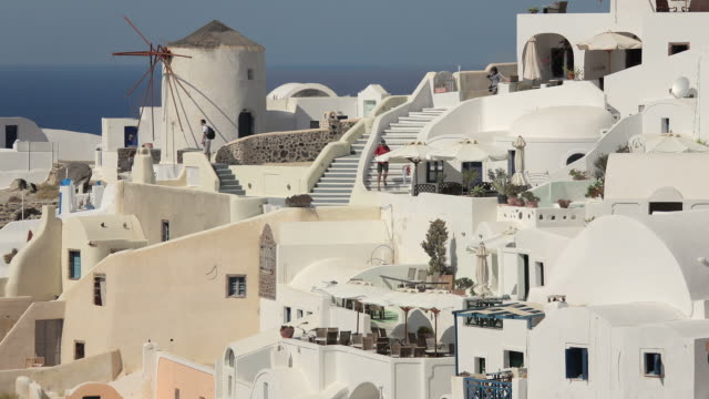 zoom back oia with windmills day 2 - oia santorini stock videos & royalty-free footage