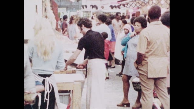 zoom butcher cuts meat on london market stall; 1973 - multiple image stock videos & royalty-free footage