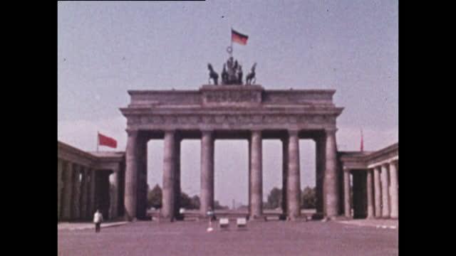 zoom from east german flag on brandenburg gate; 1970 - germany stock videos & royalty-free footage
