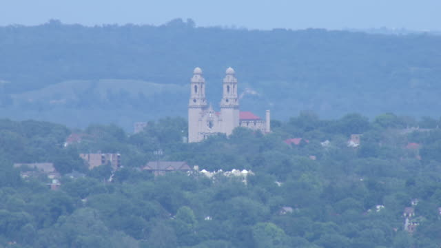 Zoom from CU to WS of St. Cecilia's Catholic Church with twin spires