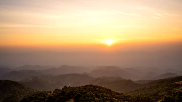 ws zoom in 4k time lapse sunrise over the mountains. - twilight stock videos & royalty-free footage