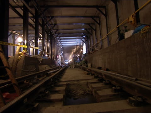 zoom in along subway tracks in subway station at world trade center construction site / new york city - september 11 2001 attacks stock videos & royalty-free footage