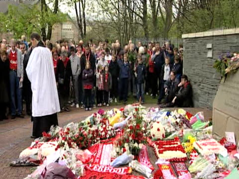 zoom in and out as group of liverpool fans hold minutes silence during memorial service marking 20th anniversary of hillsborough tragedy 15 april 2009 - memorial event stock videos and b-roll footage