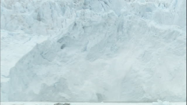 Zoom in and out on Sermeq Kujalleq glacier calving into Ilulissat Icefjord, Greenland