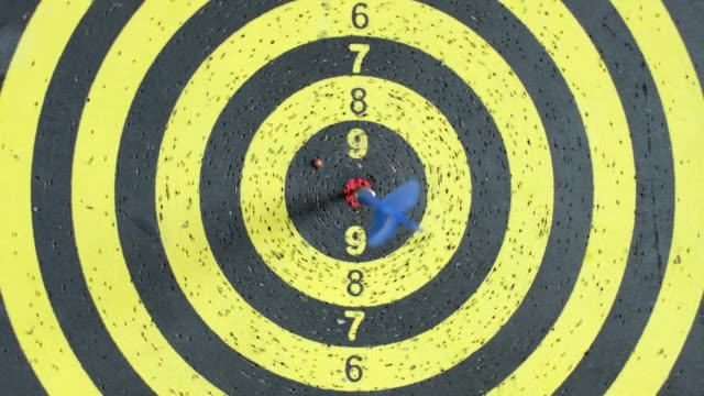 zoom in arrow in center of target board hang on wall - zoom in stock videos & royalty-free footage