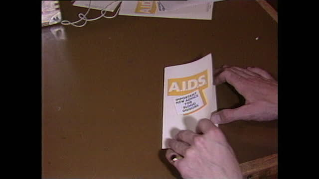 zoom in as an aids information leaflet for blood donors is opened up on a desk. - zoom in stock videos & royalty-free footage