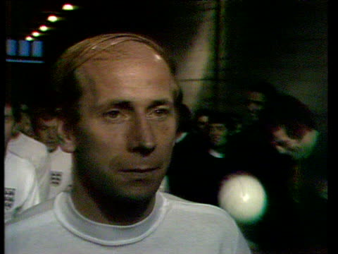 stockvideo's en b-roll-footage met zoom in as england midfielder bobby charlton prepares to lead team out for his 100th international appearance england vs northern ireland home... - verschijning
