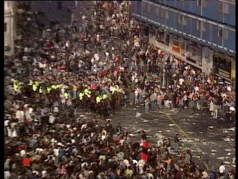 zoom in as mounted police charge through rioters in trafalgar square knocking down woman during protest against poll tax which had become violent... - 1990 stock videos & royalty-free footage