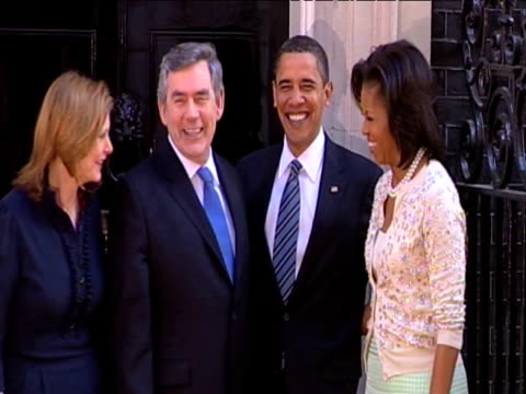 zoom in as prime minister gordon brown and wife sarah brown pose for press with president barack obama and first lady michelle obama ahead of g20... - first lady stock videos & royalty-free footage