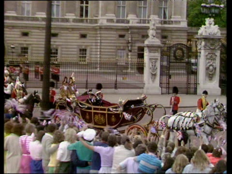Zoom in as Prince Andrew and Prince Edward wave to crowds from horse drawn carriage Royal Wedding of Prince Andrew and Sarah Ferguson 23 Jul 86