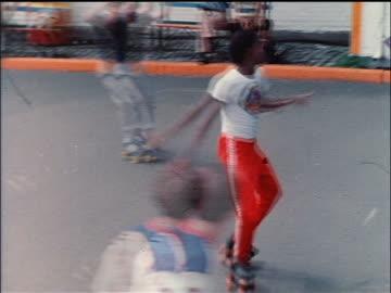 1978 zoom in black man on roller skates dancing in nyc park / educational - archivmaterial stock-videos und b-roll-filmmaterial