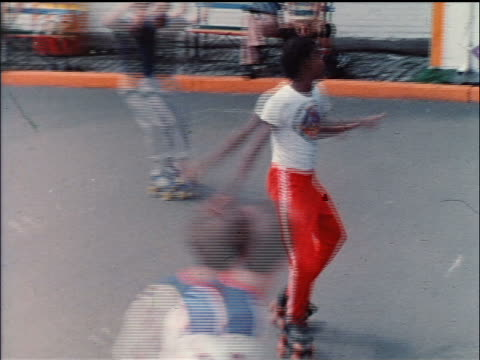 1978 zoom in black man on roller skates dancing in nyc park / educational - 1978 stock videos & royalty-free footage