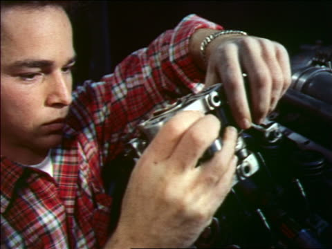 1956 zoom in close up man with plaid shirt inserting metal part onto machine - plaid shirt stock videos & royalty-free footage