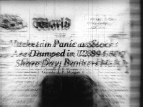 "vídeos de stock, filmes e b-roll de zoom in close up newspaper headline ""market in panic as stocks are dumped..."" / newsreel - 1920 1929"