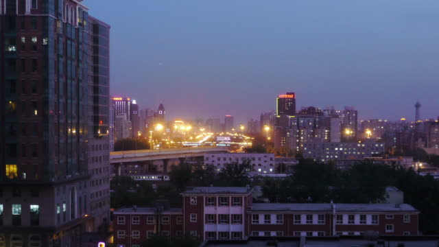 zoom in, day to night, dusk, sundown, apartmen tower, city lights, traffic, beijing, china - dusk to night stock videos and b-roll footage