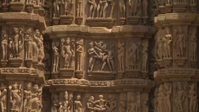 zoom in erotic sculptures khajuraho madhya pradesh - monument stock videos & royalty-free footage